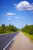 Highway and green trees Stock Photos