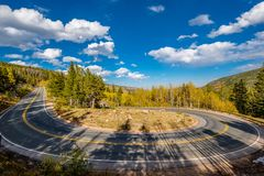 Hairpin turn at autumn in Colorado, USA. Highway with hairpin turn switchback at autumn sunny day in Rocky Mountain National Park. Colorado, USA royalty free stock image