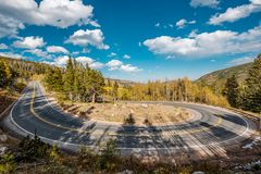 Hairpin turn at autumn in Colorado, USA. Highway with hairpin turn switchback at autumn sunny day in Rocky Mountain National Park. Colorado, USA royalty free stock photo