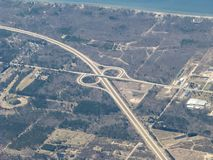 Highway half cloverleaf aerial view. Highway from up high.  Aerial view of I196/US31 at exit 36, Blue Star Highway, in Michigan.  From 10,000 feet facing Stock Photography