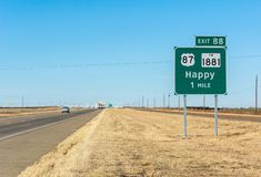 Highway 87 with Happy city limit road sign in Texas royalty free stock photo