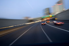 Highway Through Hartford. The interstate highway cuts through the middle of the skyscrapers of Hartford, CT. at dusk on a summers evening. Blurred motion, slow royalty free stock image