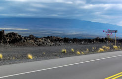 Highway through Hawaiian Lava Fields 1 Royalty Free Stock Image
