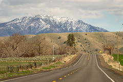 Highway 26 Heading East Oregon United States. Snow on the mountain in eastern Oregon State Stock Photos