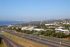 Highway Heading Toward and Leaving Coastal Urban Landscape Royalty Free Stock Photo