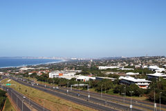 Highway Heading Toward and Leaving Coastal Urban Landscape Stock Photo