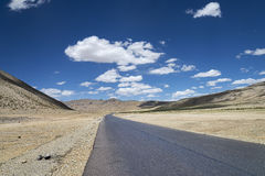 Highway among high altitude flat plateau Royalty Free Stock Photo