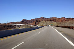 Highway and Hoover Dam bridge Stock Images