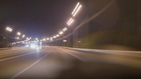 Highway hyperlapse. Defocusing flashlights cars traveling on the road.