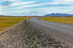 Highway through Icelandic landscape under a blue summer sky Stock Photo