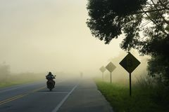 Free Highway In The Morning Fog, With Motorcycle Stock Photography - 123863562