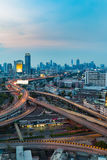 Highway intersection with city downtown background Stock Images