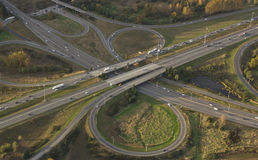 Highway Intersection at Rush Hour. Aerial view of rush hour traffic crossing interstate bridge Stock Photography