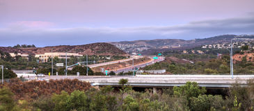 Highway in Irvine, California, at sunset. With mountain range in the distance in summer Stock Photos
