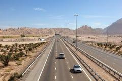 Highway at the Jebel Hafeet mountains, UAE royalty free stock image