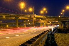 Highway Junction. Cars, racing past a huge highway junction at night Stock Photography