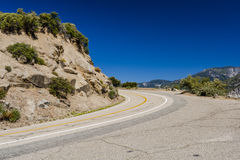 Highway 180, Kings Canyon National Park, California, USA. Steep curve at Highway 180, Kings Canyon National Park, Southern Sierra Nevada, California, USA Stock Images