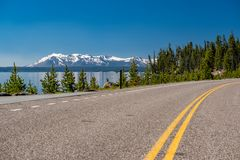 Highway by the lake in Yellowstone. National Park, Wyoming, USA Royalty Free Stock Photos
