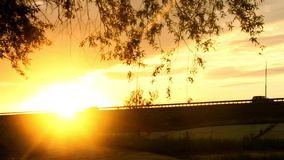 Highway in the light of the setting summer sun. View of the highway in the light of the setting summer sun stock footage