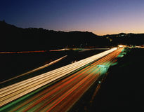 Highway with light streaks from vehicles Royalty Free Stock Photos