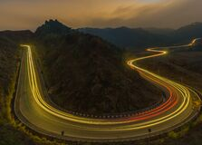 Free Highway Light Trails Of Vehicles During Rush Hour And Sunset Stock Image - 178976981