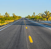 Highway in midday sun Royalty Free Stock Image