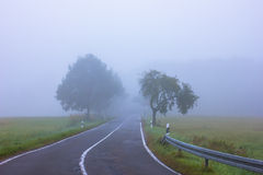 Rural Road in Mist Royalty Free Stock Photos