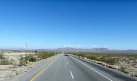 Highway in the Mojave Desert Royalty Free Stock Photos
