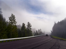 Highway in the morning fog Royalty Free Stock Photography