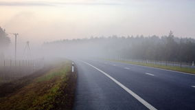 Highway in the morning mist. Morning mist over multilane highway Royalty Free Stock Image