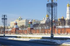 Highway on the Moskva River embankment, view of the Kremlin wall, towers and churches on the territory of the Moscow Kremlin in wi. MOSCOW, RUSSIA, FEBRUARY 01 stock photos
