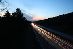 Highway - motorway view at late sunset Stock Photos