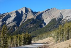 Highway and mountain in Rockies Stock Photos