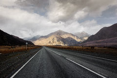 Highway in a mountain valley in Altai Stock Photos