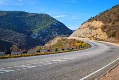 Highway among the mountains Stock Images