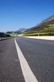 Highway in mountains. Scenic view of road or highway receding through mountainous countryside Royalty Free Stock Photos