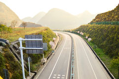 Highway in the mountains Stock Images