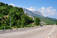 Highway in mountains Stock Images