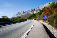 Highway in mountains and sky Stock Photos