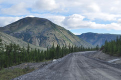 Highway in the mountains of Yakutia. Royalty Free Stock Photos