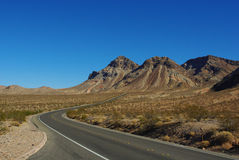 Highway through Nevada desert Royalty Free Stock Photo