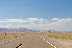Highway through Nevada desert Royalty Free Stock Image