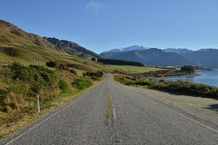 Highway New Zealand. Perspective of Highway Road streching to the mountains, South island, New Zealand Stock Photos