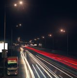 Highway at night. Blurred motion of car lights on highway at night Stock Image