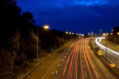 Highway at night. Busy stretch of highway / motorway at night royalty free stock photo