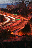 Highway at night. Large US freeway at night with cars turned into river of light. Unusual curves make this picture stand out of the crowd Stock Images