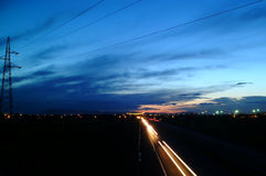 Highway at night. Traffic on a highway at night Royalty Free Stock Images