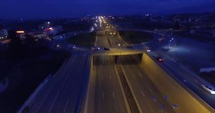 Highway at night. Aerial - Traffic on roundabout and highway at night stock video footage