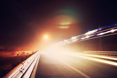 Highway Night Blurred Lights Lens Flare Guard Rail Royalty Free Stock Photos