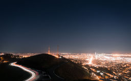 Highway at night leading to city Royalty Free Stock Image